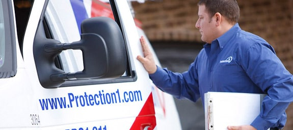 Protection One technician closing door to van