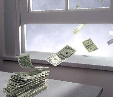Money Flying out of a window