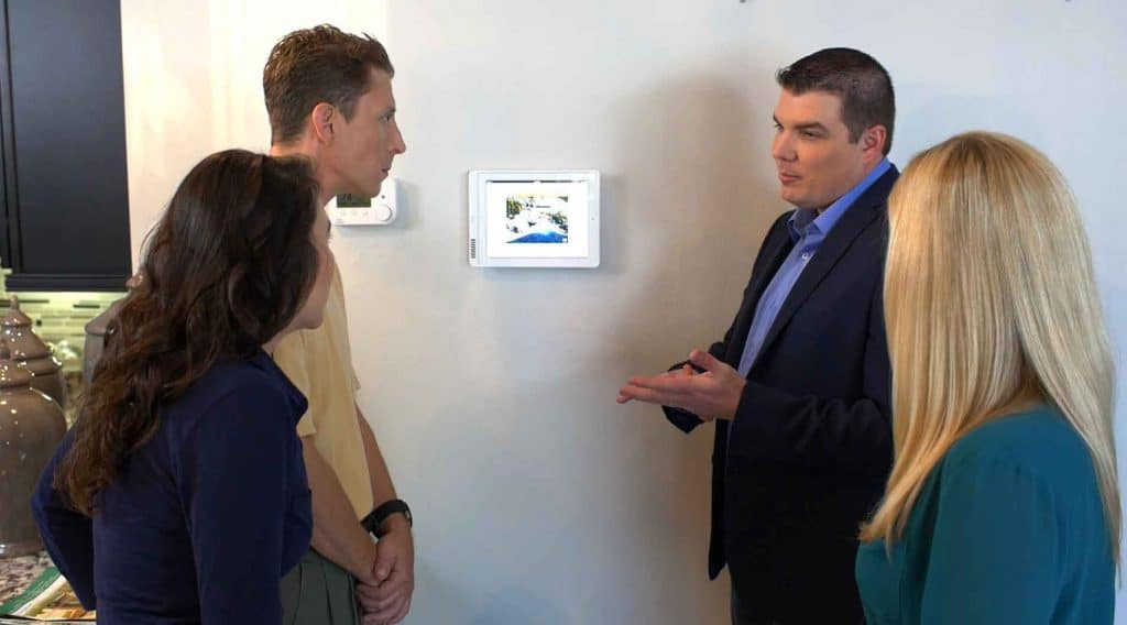 Couples Discussing Home Security System Options