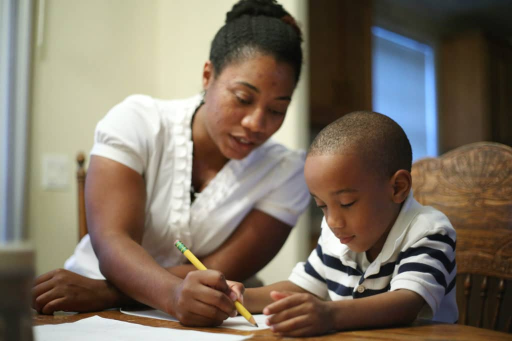 Single parent helping child do math