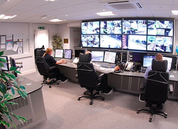 security personnels watching the cctv cameras' footage