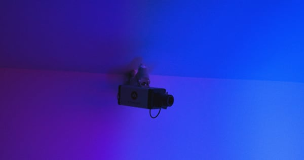 security camera attached in blue-colored room