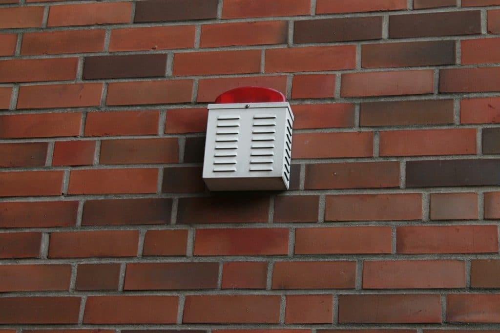 External alarm on bricked wall